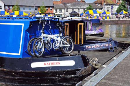 Stratford-upon-Avon, UK - May 18, 2014 - Narrowboats in the canal basin, Stratford-Upon-Avon, Warwickshire, England, United Kingdom, Western Europe