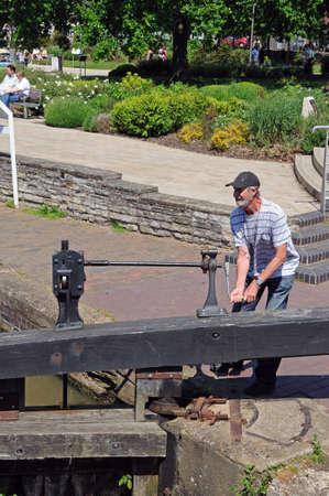 Stratford-upon-Avon, UK - May 18, 2014 - Man opening canal lock gate, Stratford-Upon-Avon, Warwickshire, England, United Kingdom, Western Europe