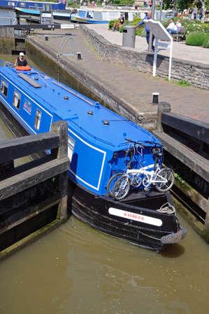 Stratford-upon-Avon, UK - May 18, 2014 - Narrowboat in the canal lock, Stratford-Upon-Avon, Warwickshire, England, United Kingdom, Western Europe.