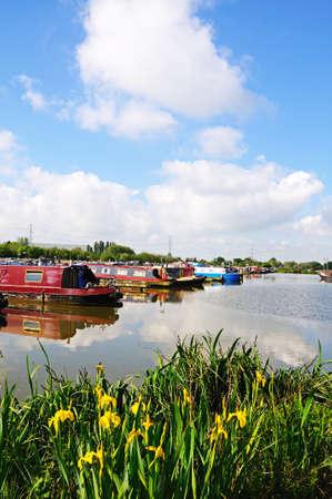 Barton-under-Needwood,m UK - May 21, 2014 - Narrowboats on their moorings in the canal basin, Barton Marina, Barton-under-Needwood, Staffordshire, England, UK, Western Europe.