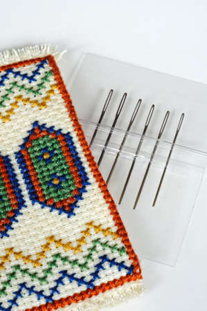 Tapestry/embroidery needles in an embroidered tapestry case.