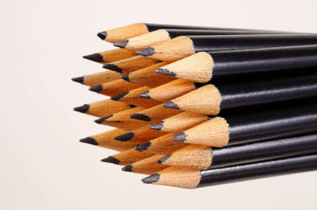 Black pencils showing the newly sharpened tips.