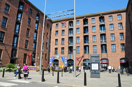 Tourists outside The Beatles Story building at Albert Dock, Liverpool, Merseyside, England, UK, Western Europe.