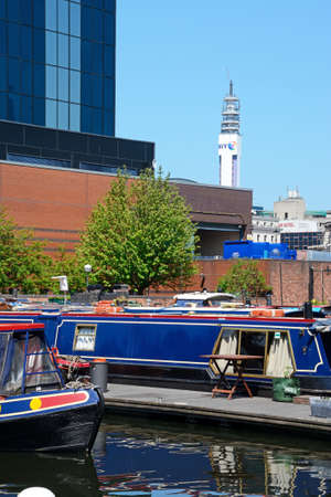 Narrowboats at Gas Street Basin with the BT tower to the rear, Birmingham, England, UK, Western Europe.
