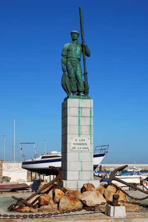 TARIFA, SPAIN - SEPTEMBER 14, 2008 - View of the fisherman statue in the port (A Los Hombres de la Mar), Tarifa, Cadiz Province, Andalusia, Spain, Europe, September 14, 2008.