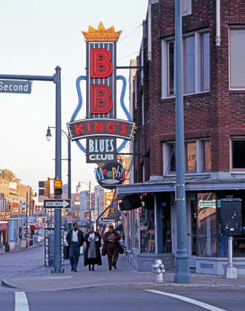 People walking past BB Kings Blues Club along Beale Street, Memphis, Tennessee, United States of America.