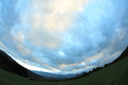 Dramatic landscape wtith cloudy sky in the French Pyrenees. Occitanie in south of France