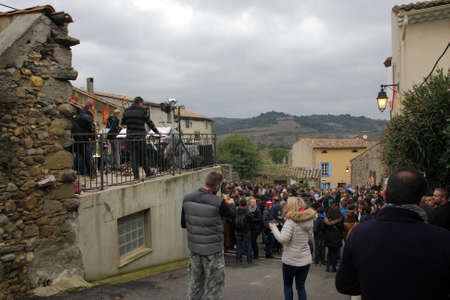 People attending a concert during festival Toques et Clocher to celebrate the vineyards of the Aude in Occitanie, France