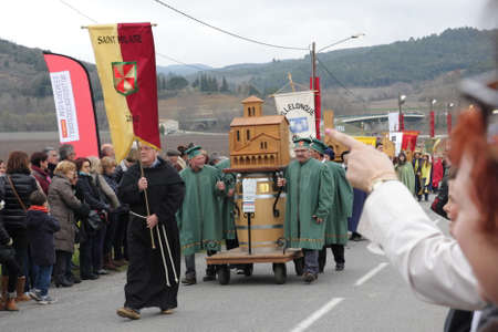 people procession during festival Toques et Clocher to celebrate the vineyards of the Aude in Occitanie, France