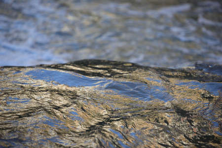 Photo pour background of colorful and iridescent reflections on the surface of running water - image libre de droit
