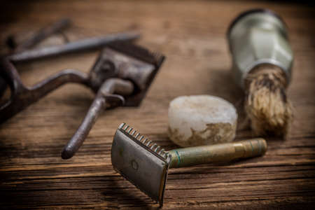 Vintage barber shop tools on old wooden background. Small depth of field.