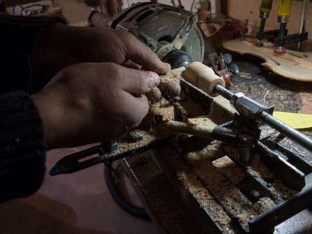 Photo pour Carpenter working on self made wood lathe with chisel - image libre de droit
