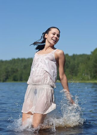 the girl jumps out of lake water