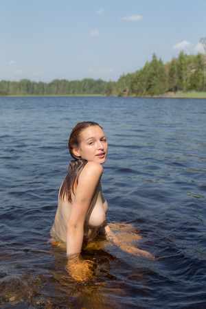 Photo for beautiful naked girl in the water of a forest lake - Royalty Free Image