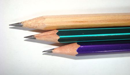 Three sharply grinded pencils on a white background