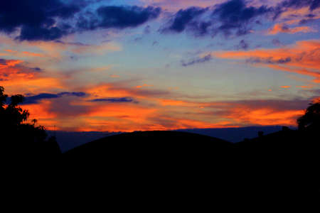Foto für the atmosphere of the evening sky before sunset, with clear skies and clouds that are slightly piled up, a mix of blue and orange colors and a pile of beautiful clouds at the end of a beautiful day - Lizenzfreies Bild