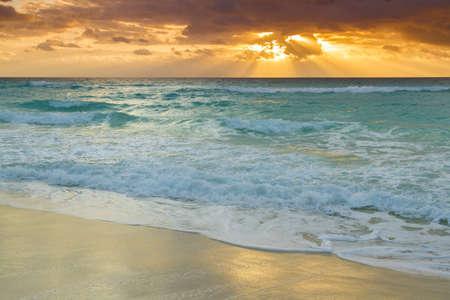 Sunset over the beach on Car