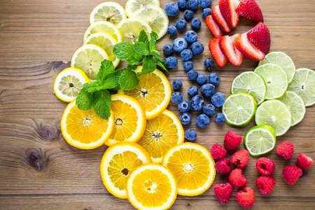Sliced fresh organic fruits prepared to make infused water.