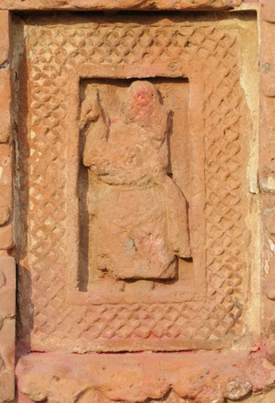 The Radha Gobinodo temple in Jaydev -Kenduli in Birbhum District of the West Bengal State in India has exquisite terracotta carvings  This part of the temple shows Hanuman- a character of a Baul singer