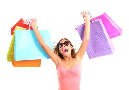 Shopping woman very excited. Dynamic picture of young woman on a shopping spree with lots of bags. Isolated on white background.
