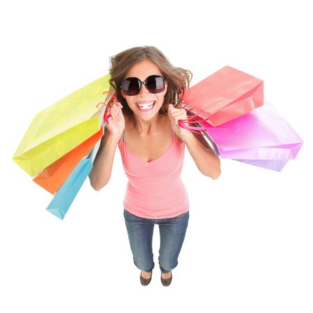 Shopping woman excited and happy. Dynamic and funny image of very hot young woman with shopping bags jumping in full length. Isolated on white background.