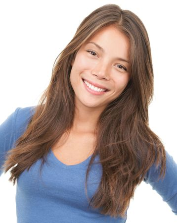 Multiracial woman smiling looking at camera wearing blue blause. Mixed chinese / caucasian female model isolated on white background.