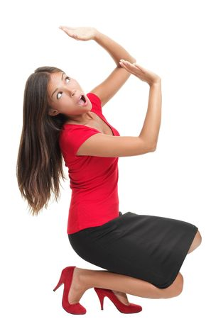 Business Woman defending herself under pressure from something...Work load or too much weight on her shoulders.