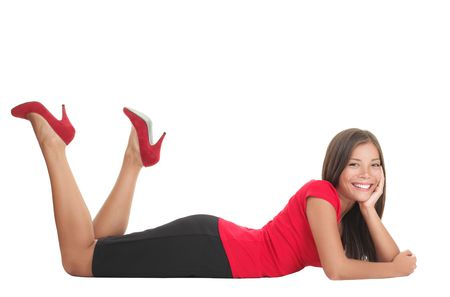 Woman lying down on the floor isolated on white. Casual young relaxed and happy woman cut out in full length. Mixed Asian Chinese / Caucasian model.