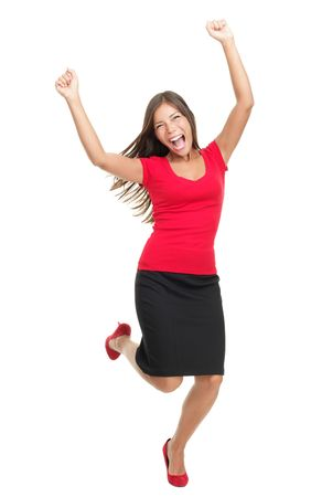Success / Winner woman. Casual young successful businesswoman jumping very excited. Isolated in full body on white background.