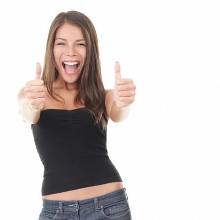 Success woman showing thumbs up. Excited beautiful woman isolated on white background. Mixed Asian Caucasian model