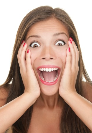 Funny surprised expression on a young woman's face. Asian caucasian person.