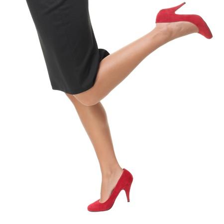 Woman legs running in red high heels - closeup.