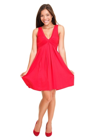 Gorgeous woman. Portrait of beautiful smiling young woman standing in cute red dress isolated on white background in full length. Sexy mixed race Chinese Asian / Caucasian female model.