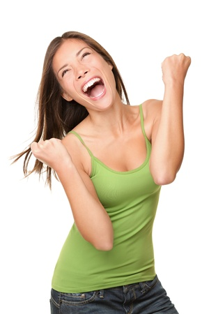 Winning success woman happy ecstatic celebrating being a winner. Dynamic energetic image of multiracial Caucasian Asian female model isolated on white background waist up.
