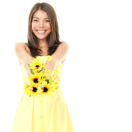 383f4f1c63564 Woman smiling showing yellow flowers isolated on white background.  Beautiful fresh young mixed race Asian