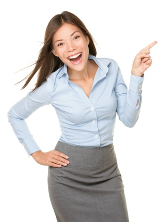 Pointing woman excited, happy and cheerful showing empty copy space with room for product, text etc. mixed race Asian Caucasian woman professional isolated on white background.