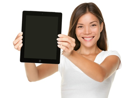 Foto de Tablet computer. Woman showing touchpad screen of tablet PC. Touch pad screen and model both in focus. Happy Multiracial Asian Caucasian girl smiling isolated on white background - Imagen libre de derechos