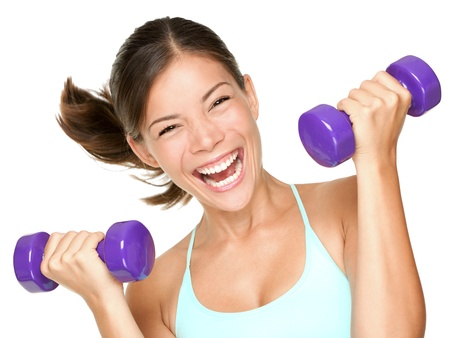 Foto de Happy fitness woman lifting dumbbells smiling cheerful, fresh and energetic. Mixed race Asian Caucasian fitness girl training isolated on white background. - Imagen libre de derechos