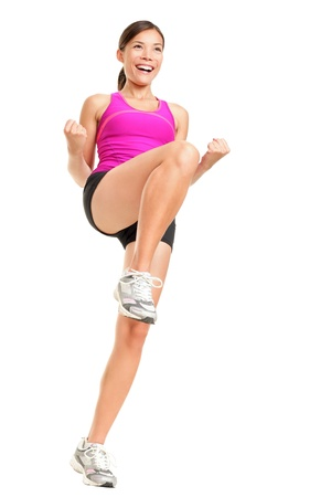 Aerobics fitness woman instructor exercising isolated in full body. Happy smiling and energetic fit female fitness model in pink top.