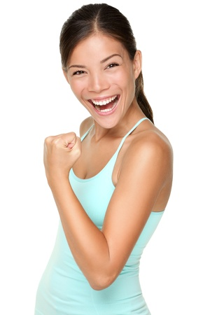 Photo pour Fitness woman showing fresh energy flexing biceps muscles smiling happy isolated on white background. Beautiful fit mixed race Asian Caucasian female fitness model energetic and fun. - image libre de droit