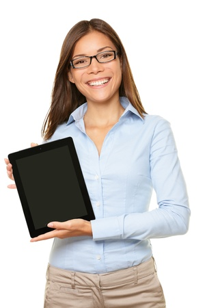 Foto de woman showing tablet computer screen smiling wearing glasses isolated on white background. - Imagen libre de derechos
