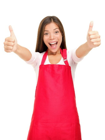 Happy small business owner excited in red apron showing thumbs up success sign isolated on white background.