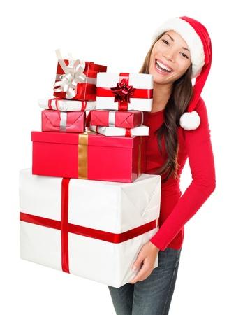 43db7ad963292 Asian christmas santa woman shopping holding many gifts wearing santa hat  smiling happy. Beautiful female