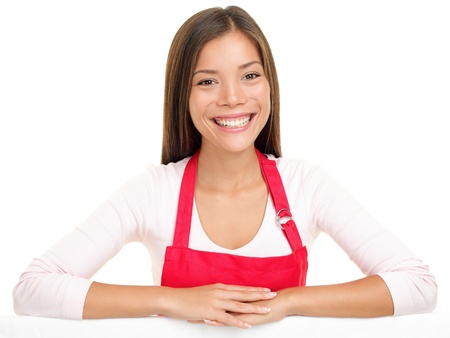 apron woman sales assistant clerk smiling happy with arms on edge for sign or similar. Beautiful content and joyful female model isolated on white background