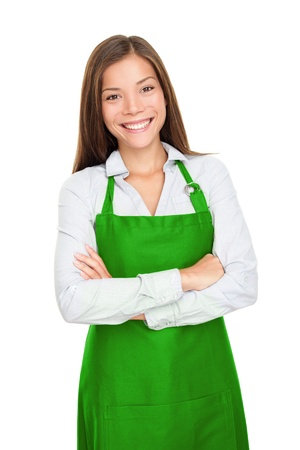 Small shop owner, entrepreneur or sales clerk standing happy and proud wearing apron. Young woman isolated on white background.