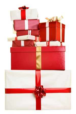 Christmas gifts isolated. Pile of christmas presents stacked isolated on white background. Red and white colors.