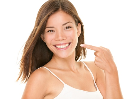 Photo pour Dental teeth - perfect smile woman pointing at toothy smile looking happy at camera.  - image libre de droit