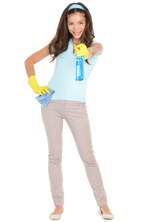 Photo pour Spring cleaning woman pointing cleaning spray bottle shooting at camera.  - image libre de droit