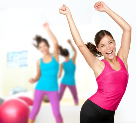 Fitness dance class aerobics  Women dancing happy energetic in gym fitness class