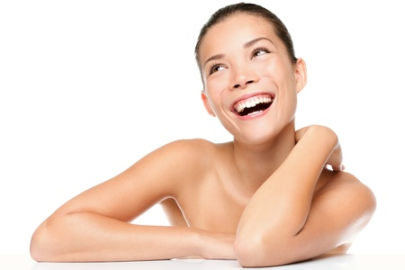 Foto de Skin care beauty woman laughing smiling happy and cheerful. Asian / Caucasian mixed race female beauty model isolated on white background. - Imagen libre de derechos